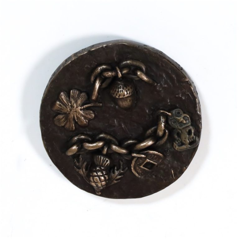 Bronze Medallion by Fiona Garlick They Came with Their Seeds Dreams and Stories obverse