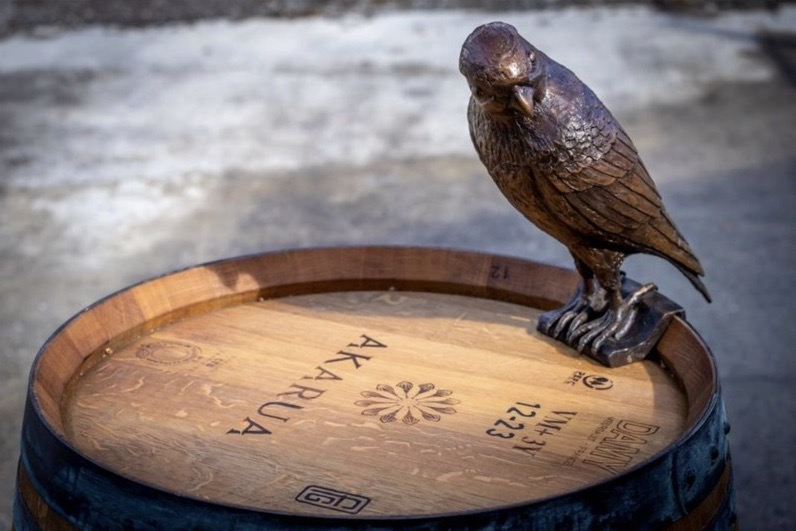 The Sentinal bronze sculpture on a wine barrel detail of falcon